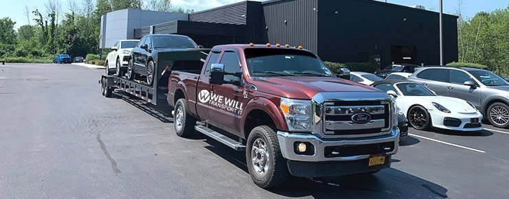 Open car transport red truck shipping cars nationwide