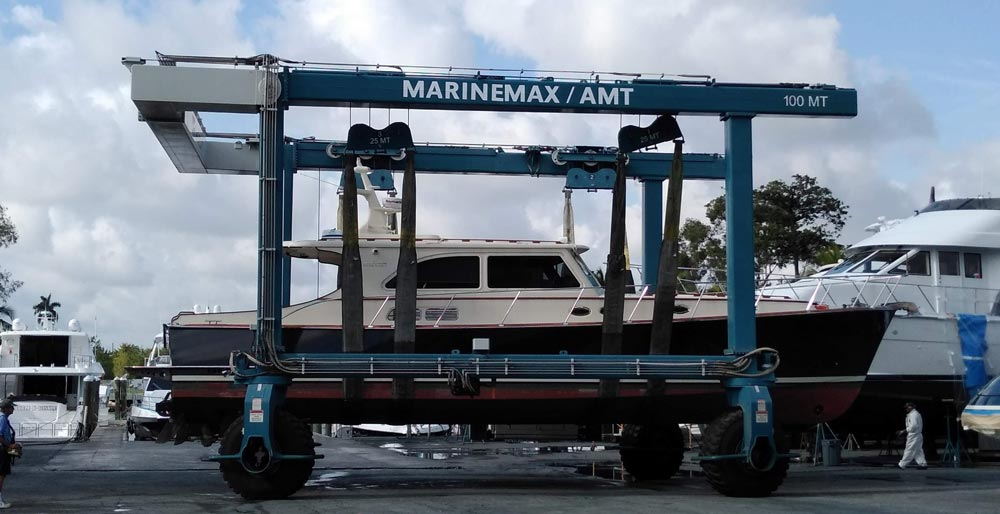 Yacht being transported for a huge blue truck, Boat Transport Alabama