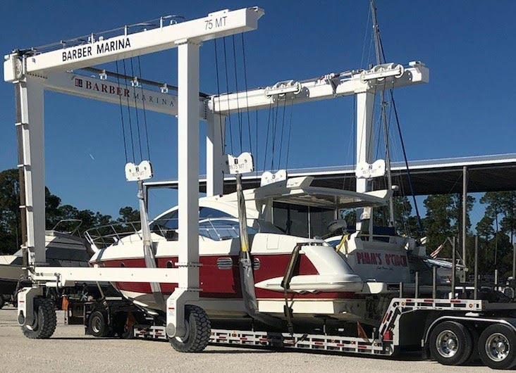 White and red yacht ready to be transported, Boat Transport Wisconsin