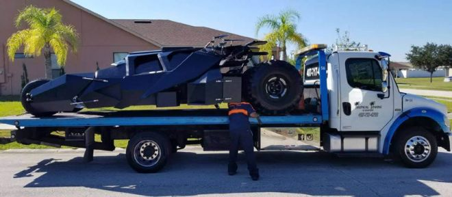 Single Car flatbed carrier, with the batmobile vehicle, worth millions of dollars