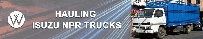 Hauling Isuzu NPR Trucks, We Will Transport it, Vehicle Transport Company hauling isuzu npr trucks
