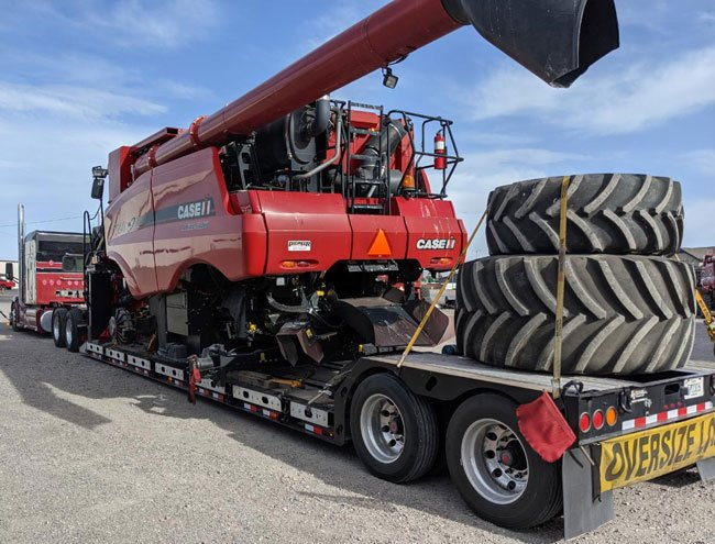 Heavy Equipment Transport with Tire Service