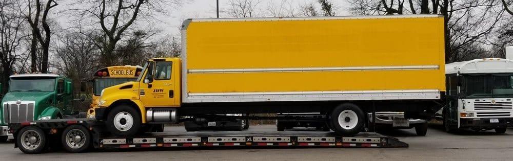 Truck Shipping Companies hauling a yellow truck