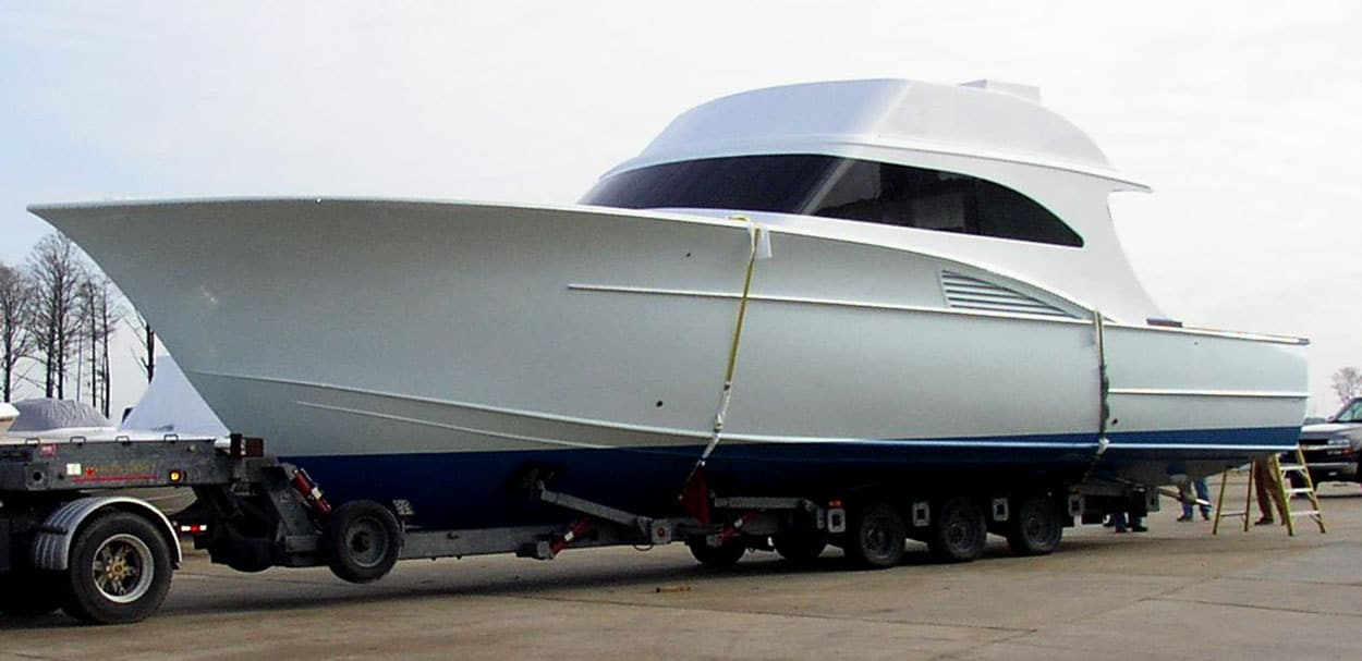 Boat Transport Colorado, Huge white boat on a truck trailer being transported