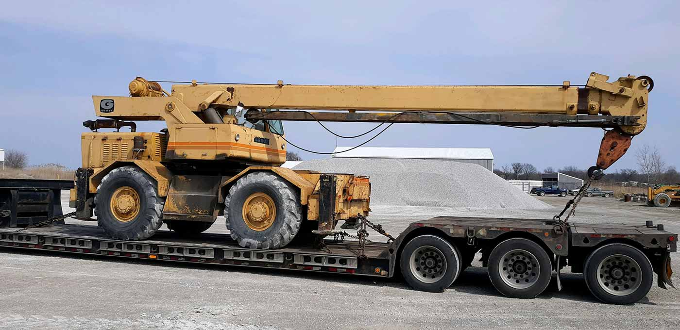 crane loaded, heavy equipment, we will transport it vehicle transport company