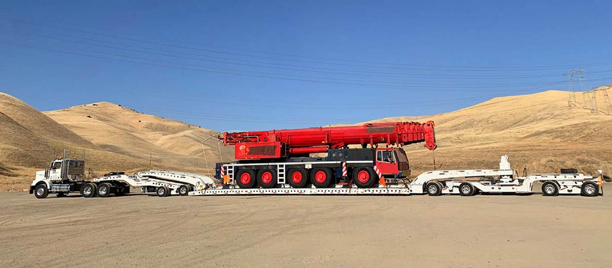 We Will Transport It boat heavy equipment transport heavy machinery vehicle transport
