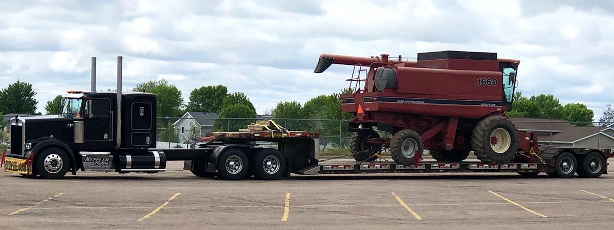 heavy equipment transport, we will transport it vehicle transport company